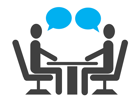 A cartoon image of people talking to each other over a table, in an interview situation, each person has a speech bubble