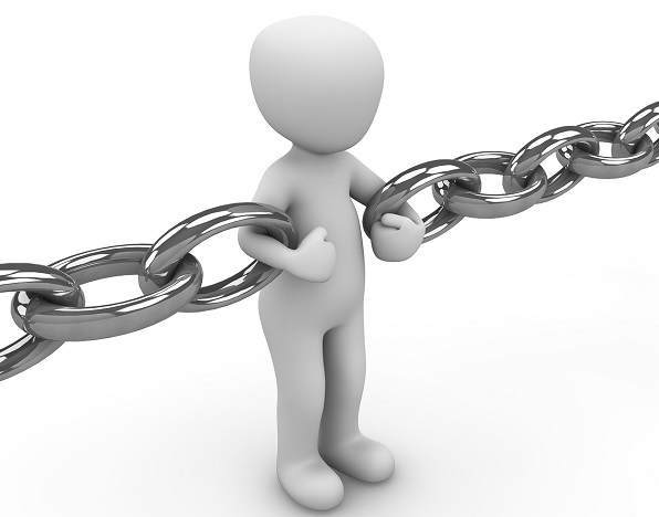 Figure holding onto links in a chunky metal chain