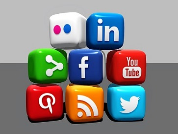 A cartoon of a set of cubes in a pile. Each cube represents an aspect of social media, including linkedin, facebook, blogger, twitter and youtube
