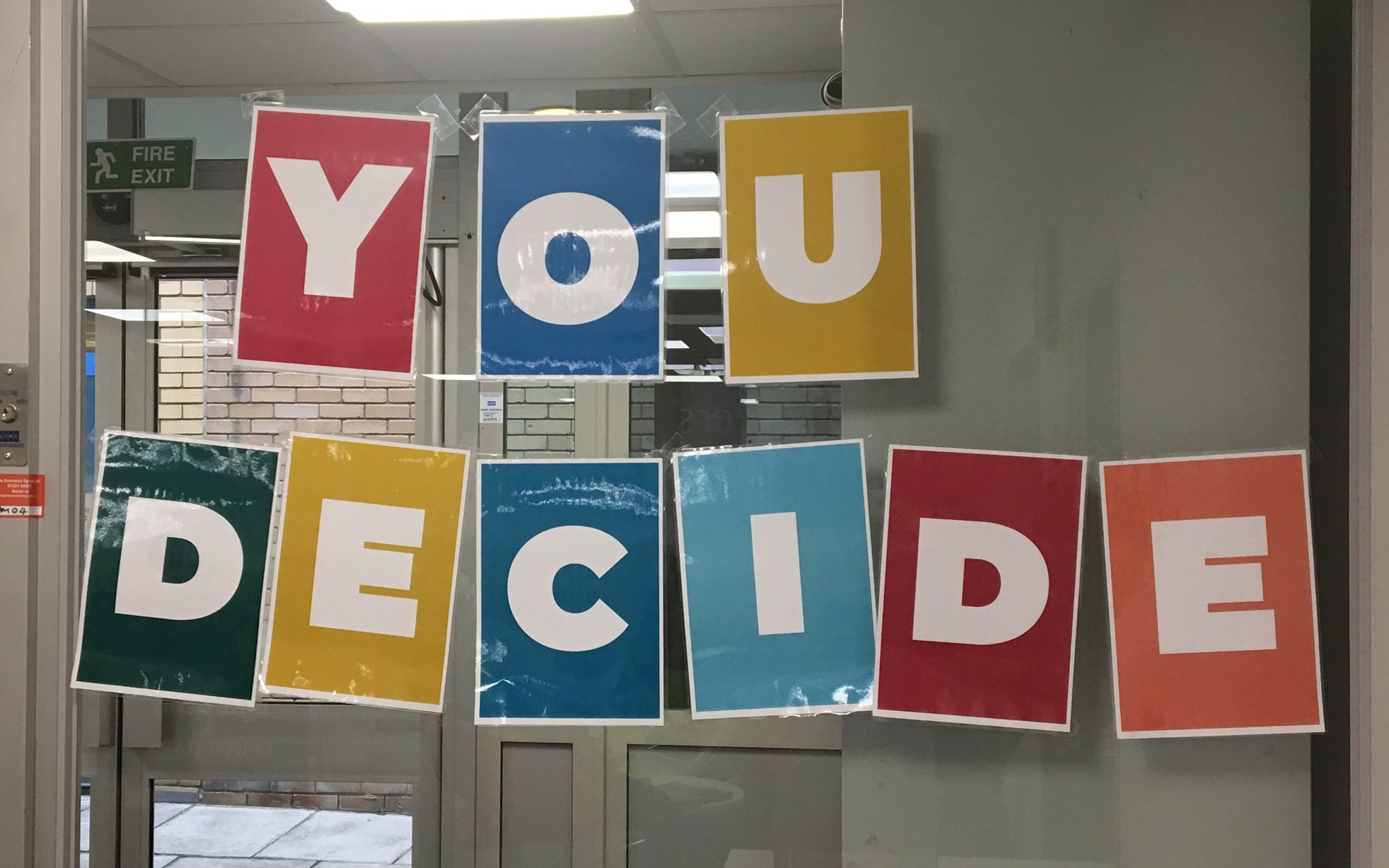 Colourful sign of You Decide