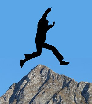 Infographic silhouette of figure leaping over the top of a mountain