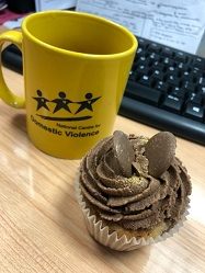 Aimee's National Centre for Domestic Violence mug and cupcake, from her placement year with the NCDV