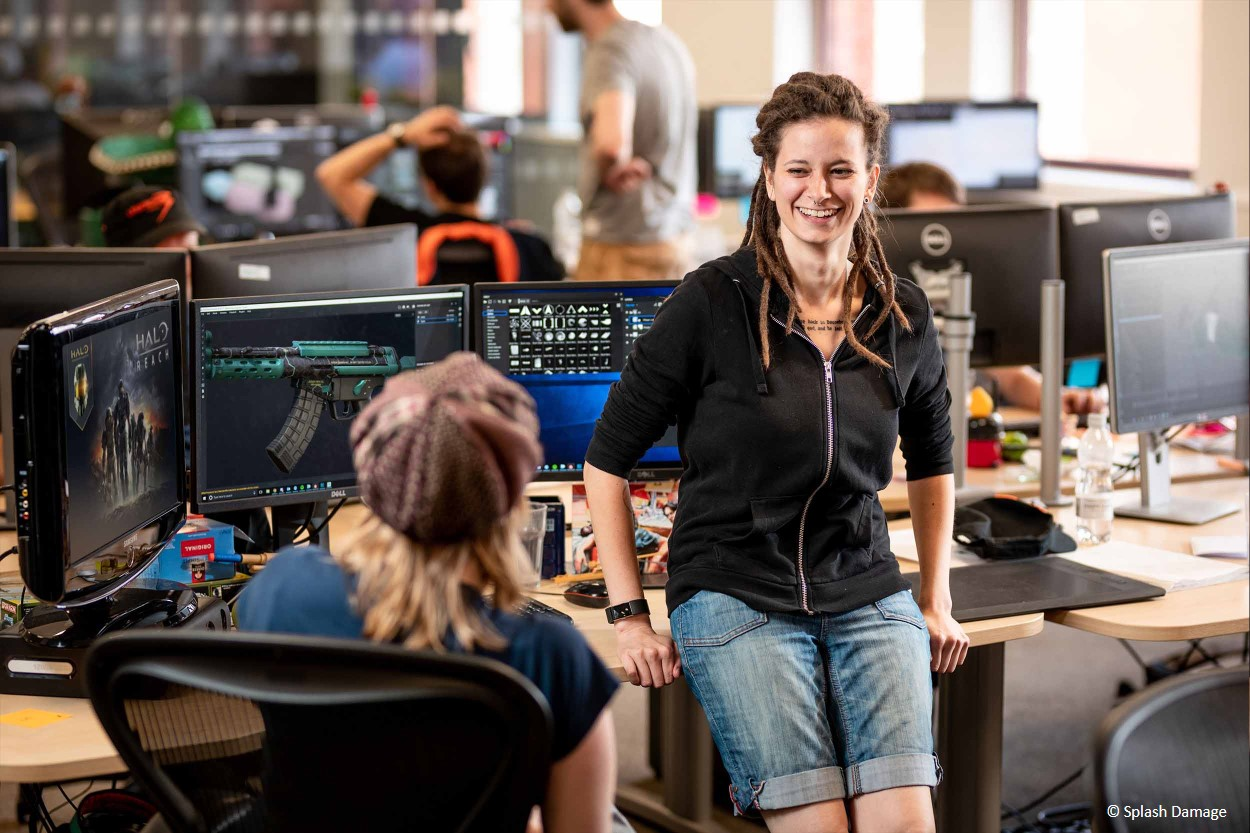 2 female games designers chatting in their office setting