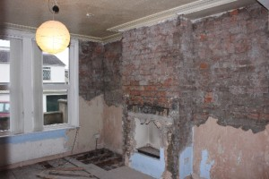 Walls stripped of plaster