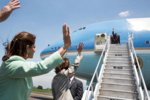 President Barack Obama waves to President Laura Chinchilla of Costa Rica, left, and others as he boards Air Force One at Juan Santamaria International Airport in San Jose, Costa Rica, May 4, 2013. (Official White House Photo by Pete Souza) This official White House photograph is being made available only for publication by news organizations and/or for personal use printing by the subject(s) of the photograph. The photograph may not be manipulated in any way and may not be used in commercial or political materials, advertisements, emails, products, promotions that in any way suggests approval or endorsement of the President, the First Family, or the White House.