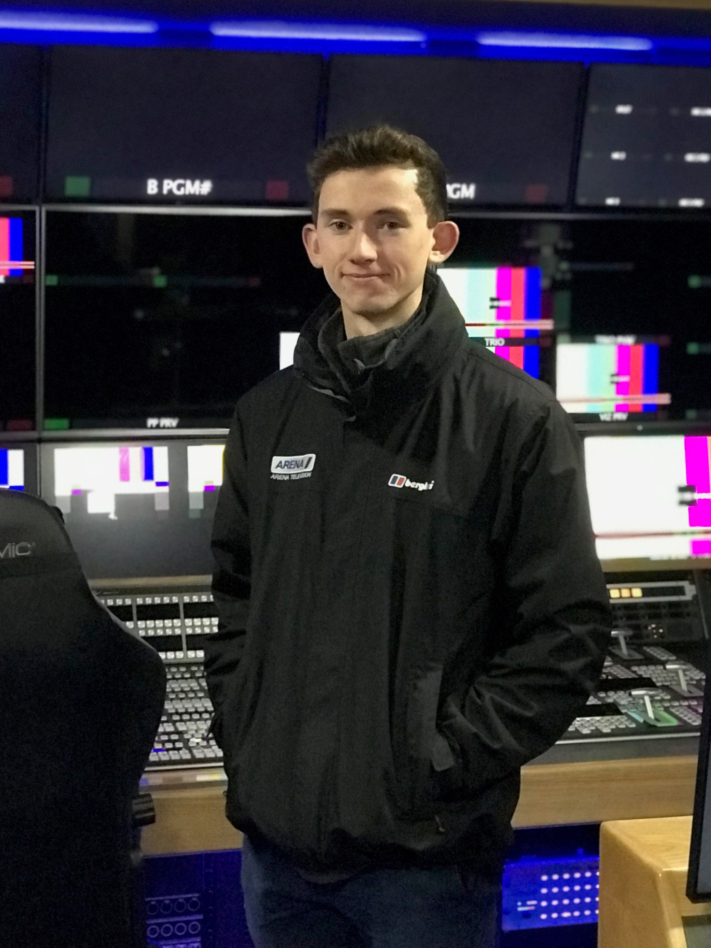Student in front of TV production gallery