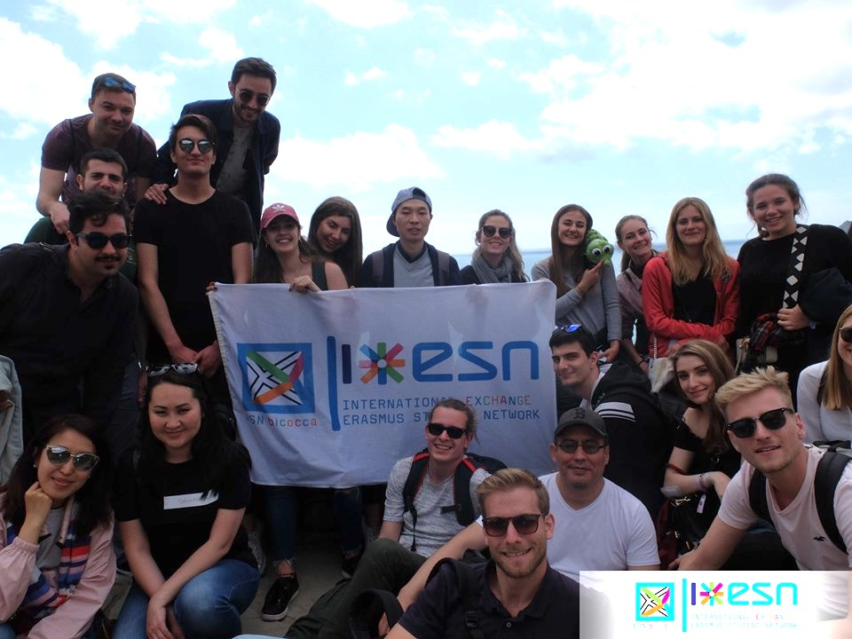 The Erasmus students holding the Erasmus Student Network Flag