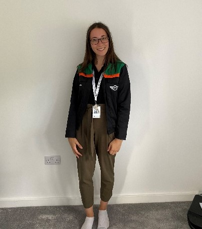 Issy wearing her work uniform and lanyard