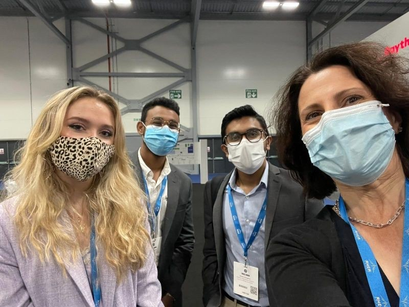 The Clutch Space team wearing face masks at an expo this summer