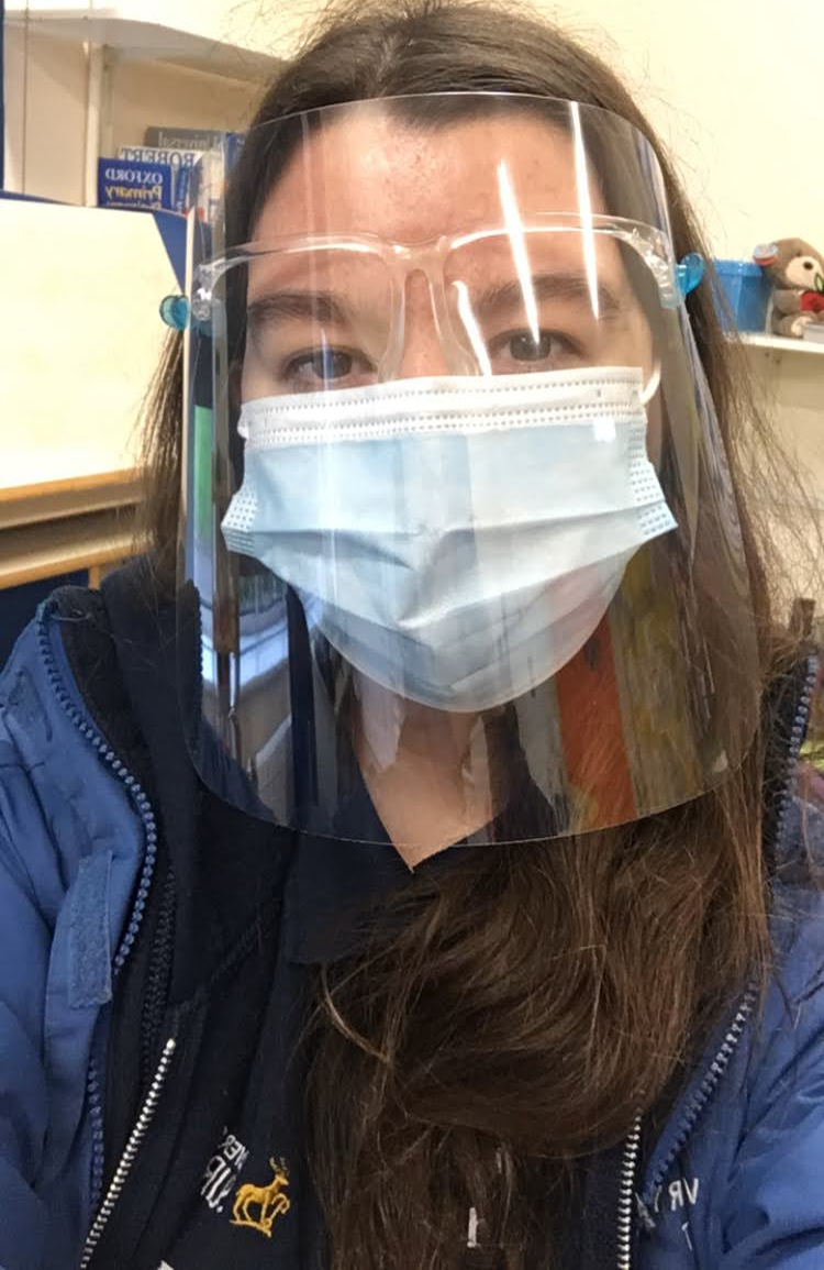 Student Ambassador wearing a face mask and shield to be COVID safe whilst working