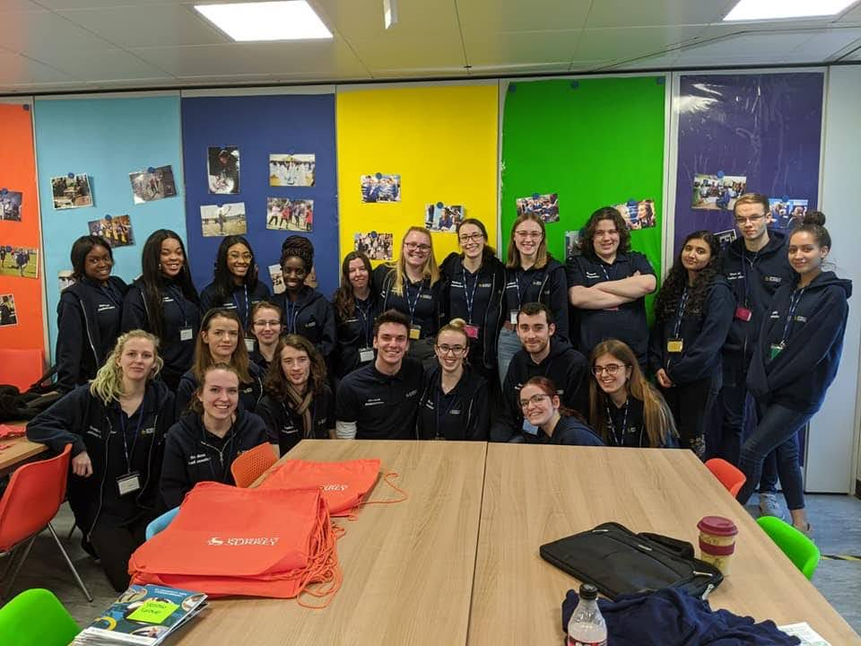 Group of student ambassadors smiling after completing a sustained widening participation programme for Year 8s Year 8 week