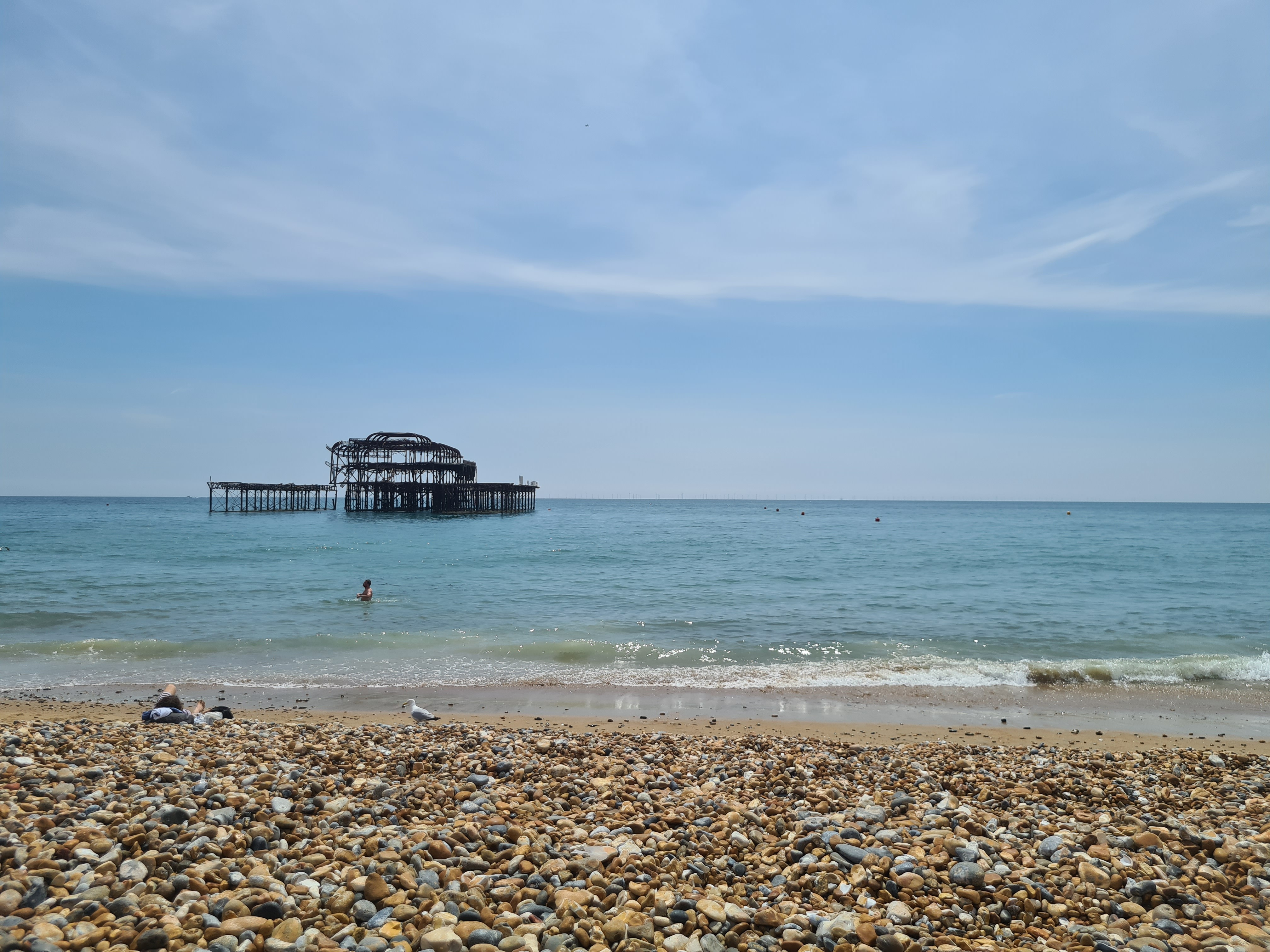 A photograph of Brighton Beach with the old pier in the distance