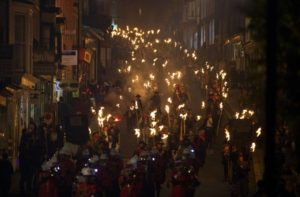 Bonfire societies parade through the streets of Lewes in Sussex, on November 5, 2014, during the traditional bonfire night celebrations. Bonfire Night is related to the ancient festival of Samhain, the Celtic New Year. Processions held across the South of England culminate in Lewes on November 5, commemorating the memory of the seventeen Protestant martyrs. Thousands of people attend the parade through the narrow streets until the evening comes to an end with the burning of an effigy, or 'guy,' usually representing Guy Fawkes, who died in 1605 after an unsuccessful attempt to blow up The Houses of Parliament. AFP PHOTO / JUSTIN TALLISJUSTIN TALLIS/AFP/Getty Images